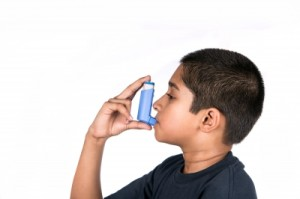 Kid using an asthma inhaler